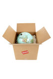 Globe in a box with a fragile sticker Stock Photos
