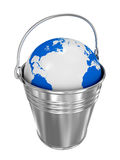 Globe in bucket on white background Royalty Free Stock Image