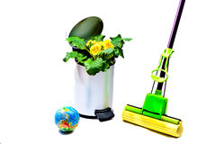 The globe, bunch of flowers in a garbage bucket, m stock images