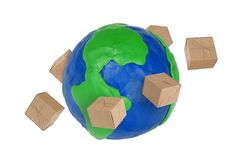 Globe and cardboard boxes Stock Image