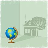 Globe casting shadow of house and tree Stock Image