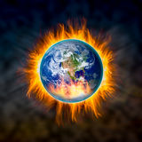 Globe catching fire Royalty Free Stock Image