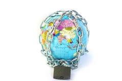Globe in chain Stock Photography