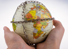 Globe in chains Royalty Free Stock Images