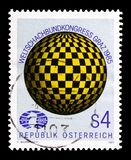 Globe with chequered pattern & badge, World Chess Federation serie, circa 1985. MOSCOW, RUSSIA - AUGUST 18, 2018: A stamp printed in Austria shows Globe with royalty free stock photography