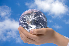The globe in children's hands Royalty Free Stock Photos