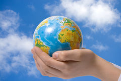 The globe in children's hands Royalty Free Stock Photo