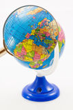 Globe for children with sharpener. With magnifier over Europe Royalty Free Stock Images