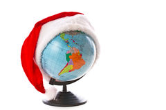 Globe in a Christmas cap Stock Photography