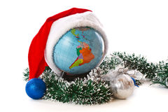 Globe in a Christmas cap Stock Photo