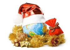 The globe in a Christmas cap Royalty Free Stock Photos