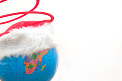 Globe with christmas hat Royalty Free Stock Images