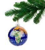 Globe and christmas tree Royalty Free Stock Image