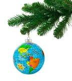 Globe and christmas tree Stock Image