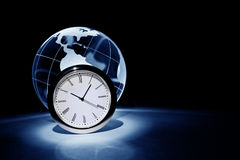 Globe and clock Royalty Free Stock Photo