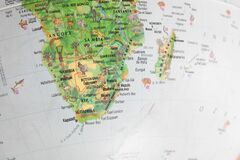 Globe close up. Map of continents - Africa. An indispensable device for geography lessons