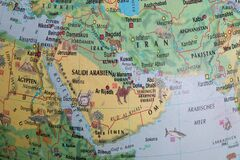 Globe close up. Map of continents - Arabian peninsula. An indispensable device for geography lessons
