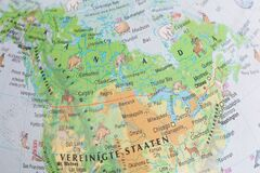 Globe close up. Map of continents - Asia. An indispensable device for geography lessons