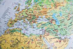 Globe close up. Map of continents of Europe and Asia. An indispensable device for geography lessons