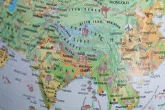 Globe close up. Map of continents - India, China, Asia. An indispensable device for geography lessons