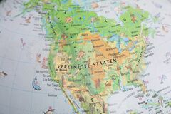 Globe close up. Map of continents - North America. An indispensable device for geography lessons