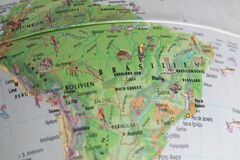 Globe close up. Map of continents - South America. An indispensable device for geography lessons
