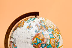The globe closeup with Africa and Europe. The globe closeup on the orange background with Africa and Europe Royalty Free Stock Images