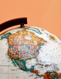 The globe closeup with North America. Orange background royalty free stock image