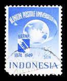 Globe, coat of Bern, U.P.U. (Universal Postal Union), 75th Anniversary serie, circa 1949. MOSCOW, RUSSIA - MAY 15, 2018: A stamp printed in Indonesia shows Globe royalty free stock photo