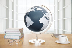 Globe and coffee on desktop Stock Photography