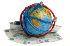 Globe coiled with wires and banknotes Royalty Free Stock Image
