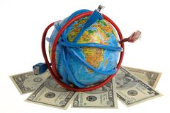 Globe coiled with wires and dollars Stock Photo