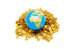 Globe and coins isolated Royalty Free Stock Photography