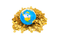 Globe and coins isolated Stock Photography