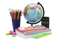 Globe with colored pencils, pen, pains, paper for school education isolated on white background. school background. Globe with colored pencils, pen, pains Stock Photo