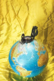 Globe and compass Stock Images