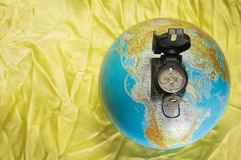 Globe and compass Royalty Free Stock Photo