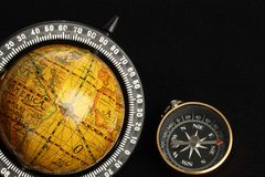Globe and a compass Royalty Free Stock Photography