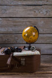 Globe and compass on suitcase. Royalty Free Stock Images