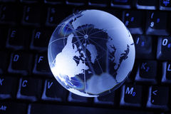 Globe and computer Royalty Free Stock Photo