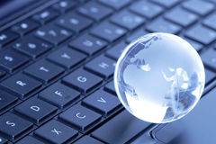 Globe On Computer Keyboard Royalty Free Stock Photos