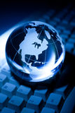 Globe and Computer Keyboard Royalty Free Stock Image