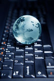 Globe on the computer keyboard Royalty Free Stock Photography