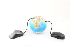 Globe and Computer Mouse. Isolated computer mouse connected to a globe. Shot over white background Stock Photography