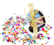 Globe and confetti on white Stock Photography