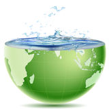Globe core with water splashing out Stock Photography