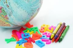 Globe with crayons. Globe with school supplies stock images