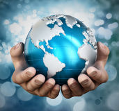 Globe in cupped hands Stock Image