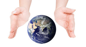 Globe cupped between open hands Royalty Free Stock Photo