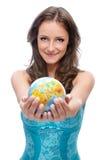 Globe d'offre de fille Photographie stock libre de droits